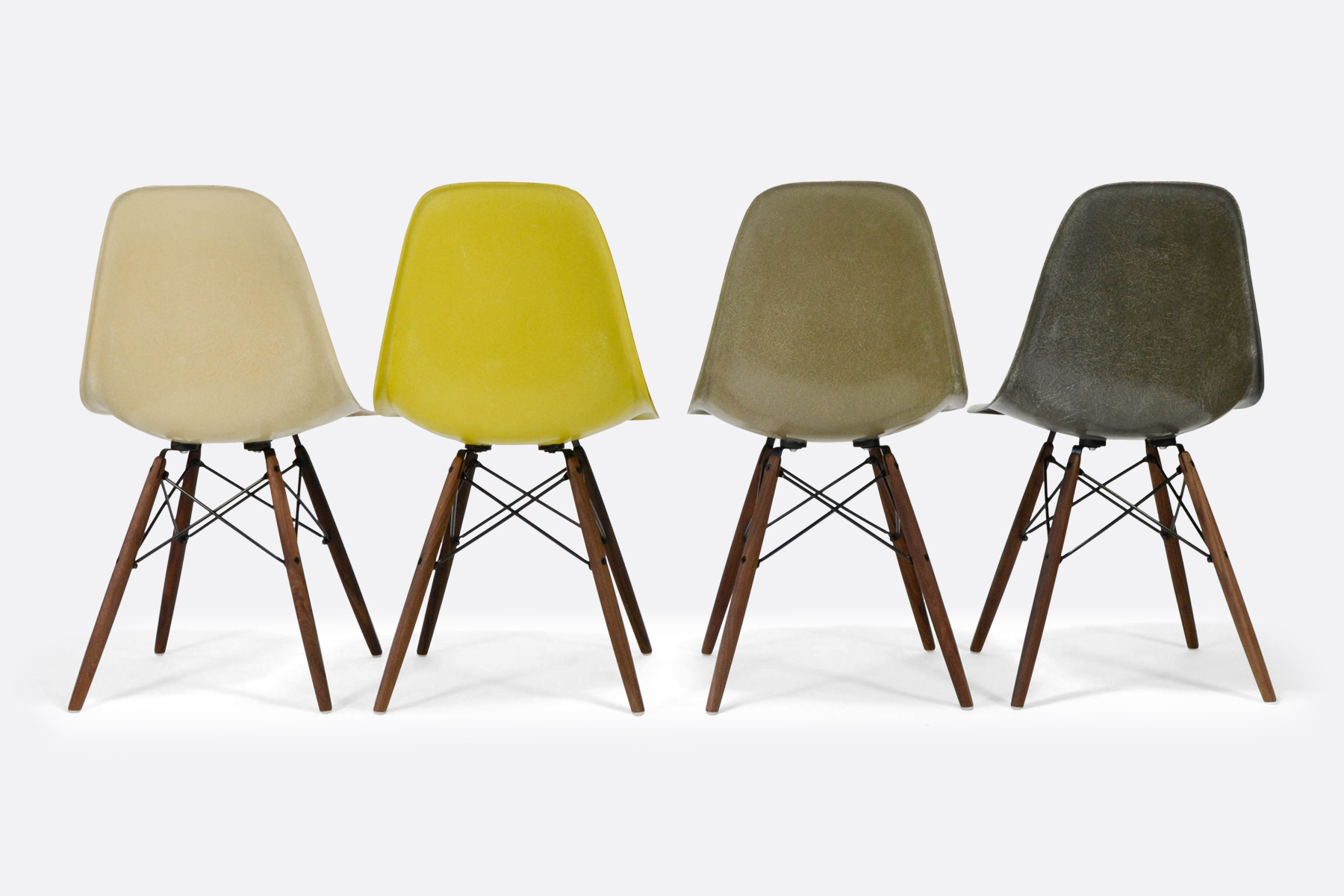 Eames-set-of-4-parchment-brilliant-yellow-raw-umber-elephant-gey-back