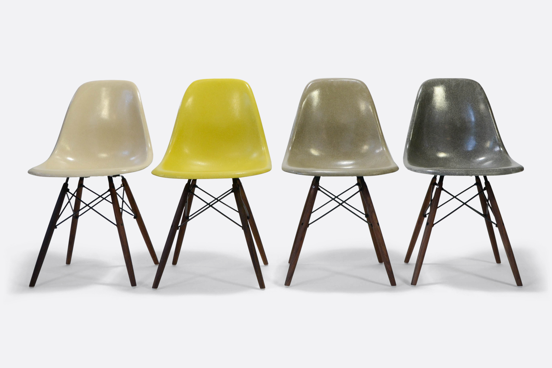 Eames-set-of-4-parchment-brilliant-yellow-raw-umber-elephant-gey-front