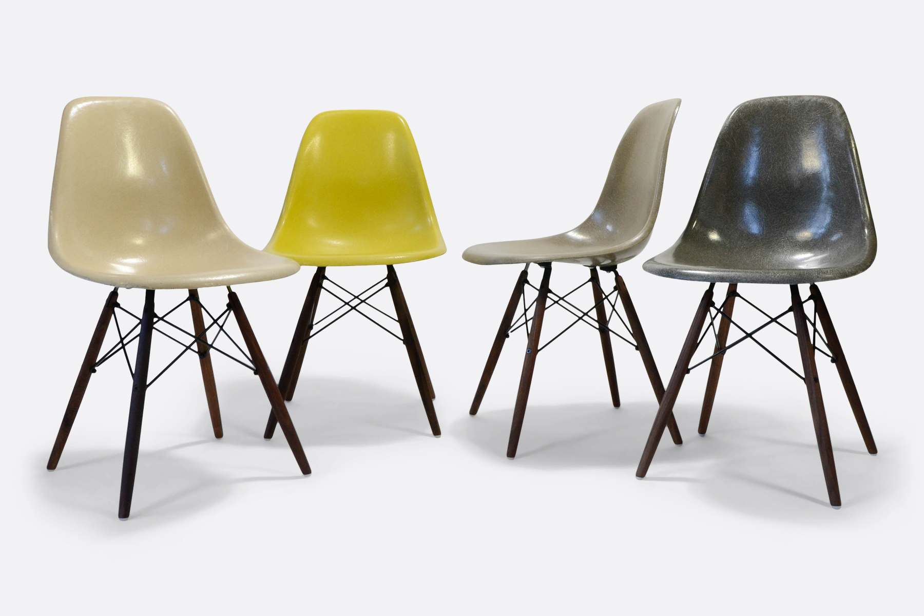 Eames-set-of-4-parchment-brilliant-yellow-raw-umber-elephant-gey-mix